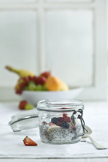 Chia pudding with fresh fruits in glass - ASF006019