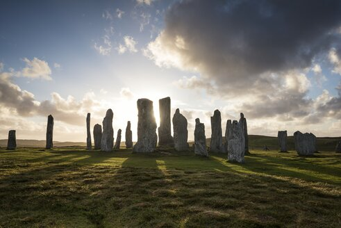 UK, Scotland, Isle of Lewis, Callanish, view to formation of standing stones at backlight - ELF001784