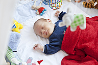 Baby sleeping in playpen with toys - MFF003138