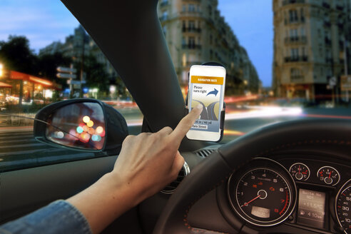 Hand using mobile phone navigation app in car - MFF003201