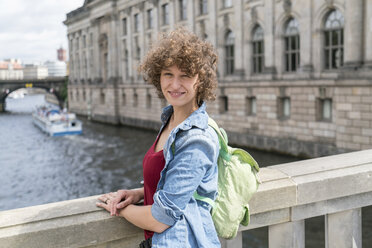 Germany, Berlin, portrait of smiling young woman standing in front of Bode Museum - TAMF000640