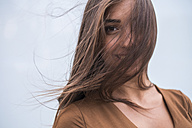 Portrait of smiling young woman with blowing hair - SIPF000834