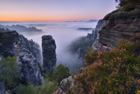 Germany, Saxon Switzerland National Park, Bastei, Hoellenhund at Raaber Kessel at sunrise - RUEF001746