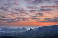 Germany, Saxon Switzerland National Park, view to Winterstein Mountain at sunrise - RUEF001749