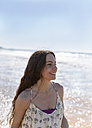 Happy young woman on the beach - MGOF002383