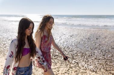 Two best friends walking along the beach - MGOF002401