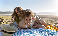 Young couple having fun on the beach - MGOF002422