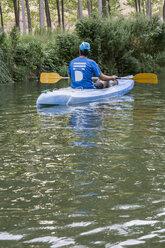 Spain, Segovia, Man in a canoe - ABZF001183