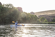 Spain, Segovia, Man in a canoe in Las Hoces del Rio Duraton - ABZF001189
