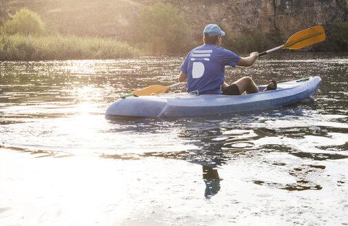 Spain, Segovia, Man in a canoe in Las Hoces del Rio Duraton - ABZF001192