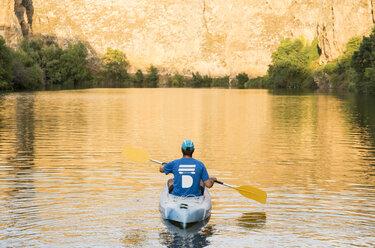 Spain, Segovia, Man in a canoe in Las Hoces del Rio Duraton - ABZF001195