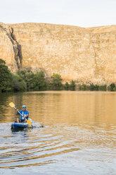 Spain, Segovia, Man in a canoe in Las Hoces del Rio Duraton - ABZF001198