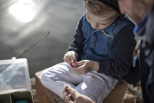 Father and son fishing together - ZEF010196