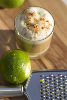 Layered coffee, condensed milk, liqueur, espresso and milk froth - YFF000573
