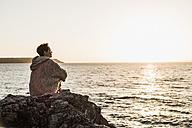 France, Crozon peninsula, woman at beach - UUF008335