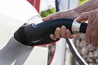 Charging of an electric car, close-up - TCF005091