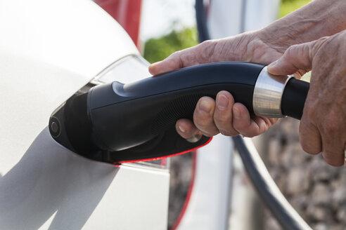 Charging of an electric car, close-up - TCF005091