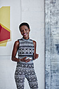 Portrait of smiling woman with smartphone - RORF00272