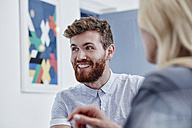 Smiling businessman in a meeting - RORF00278