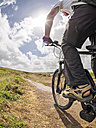France, Brittany, senior man on electric mountainbike on coastal trail - LAF01715