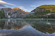 Italy, South Tyrol, Dolomites, Croda del Becco mountain reflected in lake Braies at sunrise - LOMF00386