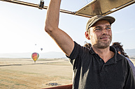 Smiling hot air balloon pilot - ABZF01227