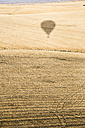 Spain, Segovia, shadow of a hot air balloon on field - ABZF01230