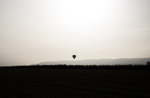 Backlighting of a hot air balloon in the sky - ABZF01236