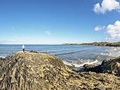 France, Brittany, Sainte-Anne-la-Palud, senior man at the beach Treguer plage - LAF01720