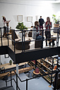 People chatting and drinking coffee in designer office - ZEF10351