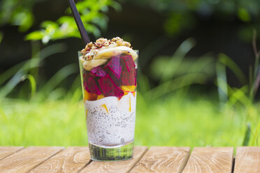 Glass of chia pudding with different fruits and cereals - KNTF00491