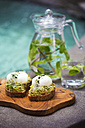 Slices of toast with mashed avocado, boiled egg and sprouts - KNTF00497