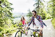 Young couple doing a bicycle trip - HAPF00844