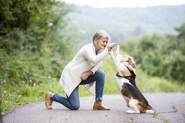 Senior woman teaching her dog - HAPF00883