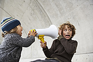 Two brothers playing with a megaphone - FSF00462