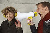 Father and son screaming at each other with magaphone - FSF00474
