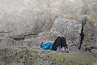 Spain, Sierra de Gredos, woman resting in the mountains - ERLF00186