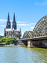 Germany, Cologne, view to Cologne Cathedral with Hohenzollern Bridge in the foreground - KRPF01826