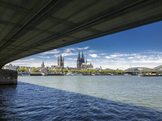Germany, Cologne, view to the city with Deutzer Bridge and Rhine River in the foreground - KRPF01829