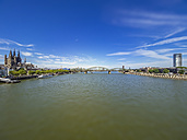 Germany, Cologne, panorama view  with Hohenzollern Bridge and Rhine River in the foreground - KRPF01832