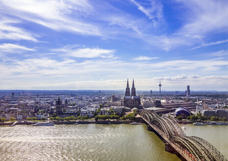 Germany, Cologne, view  to the city with Hohenzollern Bridge and Rhine River in the foreground from above - KRPF01838