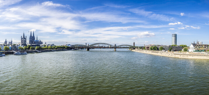 Germany, Cologne, panorama view  with Hohenzollern Bridge and Rhine River in the foreground - KRPF01841