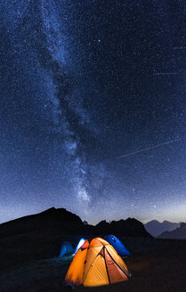 Italy, Dolomites, Milky Way over Monte Pelmo with tents of camp in the foreground - LOMF00400