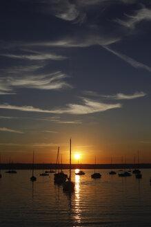 Germany, Bavaria, sailing boats at sunset on lake Ammersee - JTF00776
