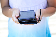 Girl's hands holding smartphone, close-up - SARF02905