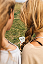 Back view of two teenage girls looking at smartphone - MGOF02454