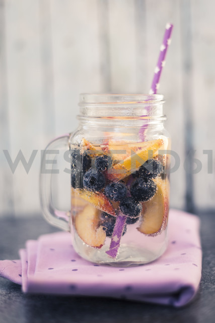 Glass of infused water with blueberries and nectarine - SARF02909