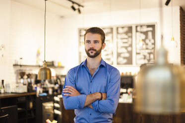 Confident young man in a cafe - DIGF01287