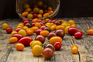 Yellow and red mini tomatoes on wood - LVF05329