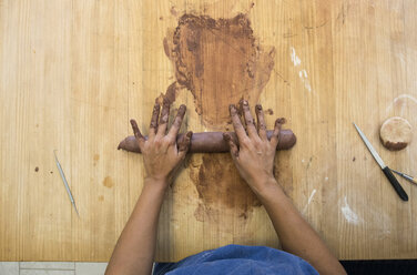 Hands of a woman working with clay in a ceramics workshop - ABZF01265